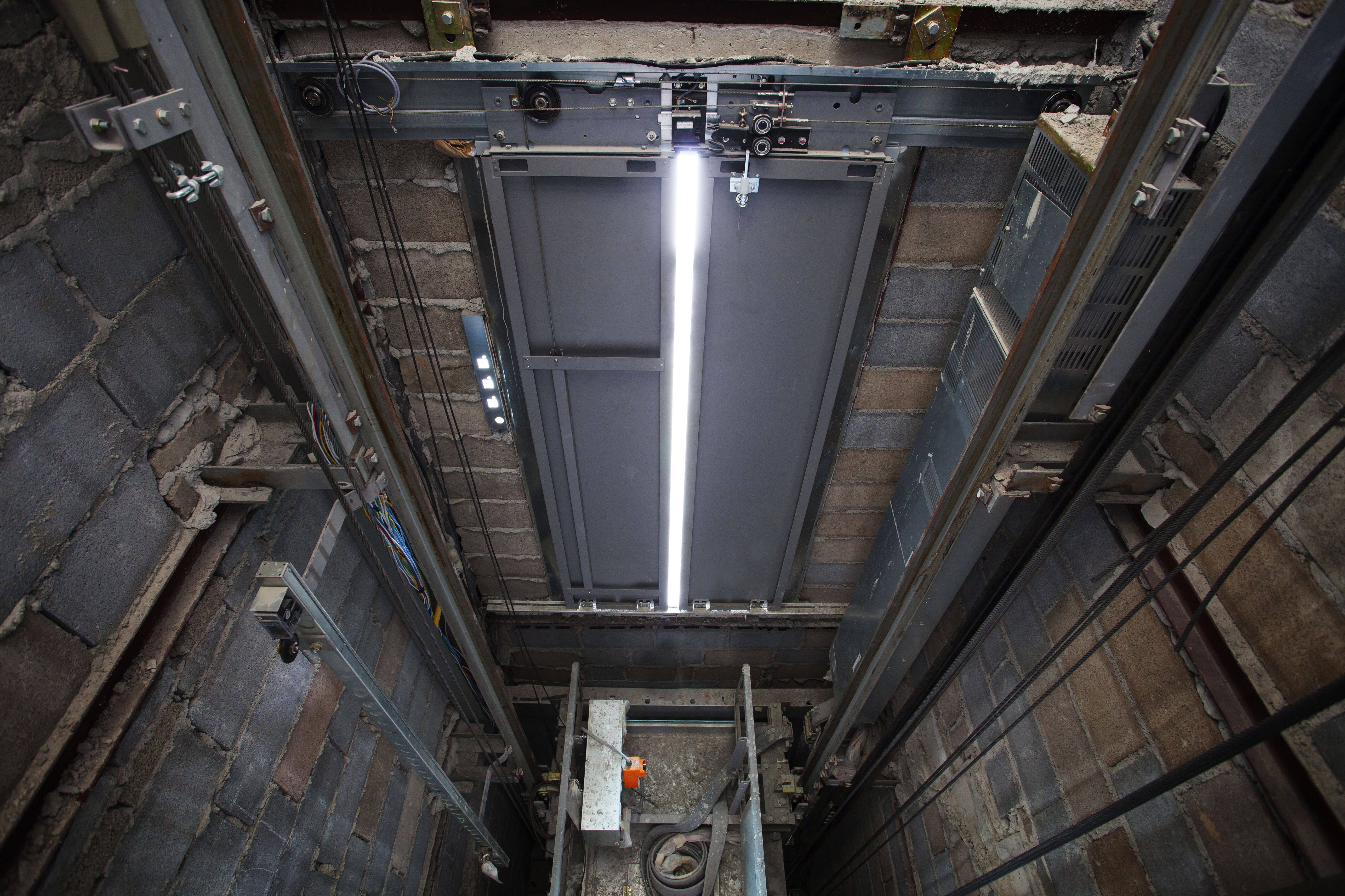 stock-photo-inside-of-roping-elevator-lift-box-built-in-high-building-show-strong-structure-use-for-217281247
