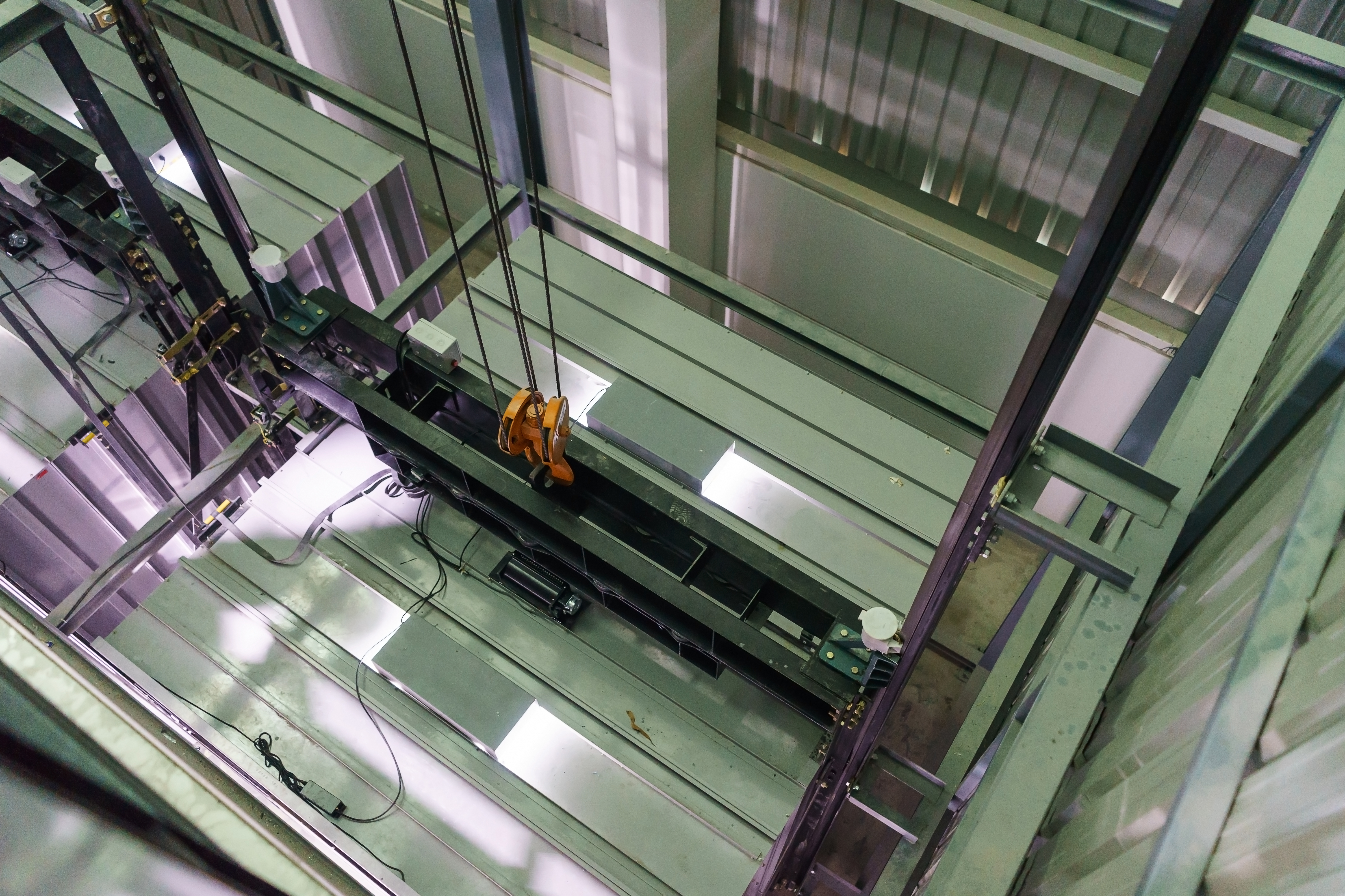 stock-photo-inside-of-roping-elevator-lift-box-built-in-high-building-show-strong-structure-use-for-752570059